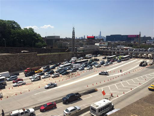 """<div class=""""meta image-caption""""><div class=""""origin-logo origin-image none""""><span>none</span></div><span class=""""caption-text"""">Traffic backed up on the New Jersey side of the Lincoln Tunnel in Weehawken, N.J. (AP Photo/ Julio Cortez)</span></div>"""