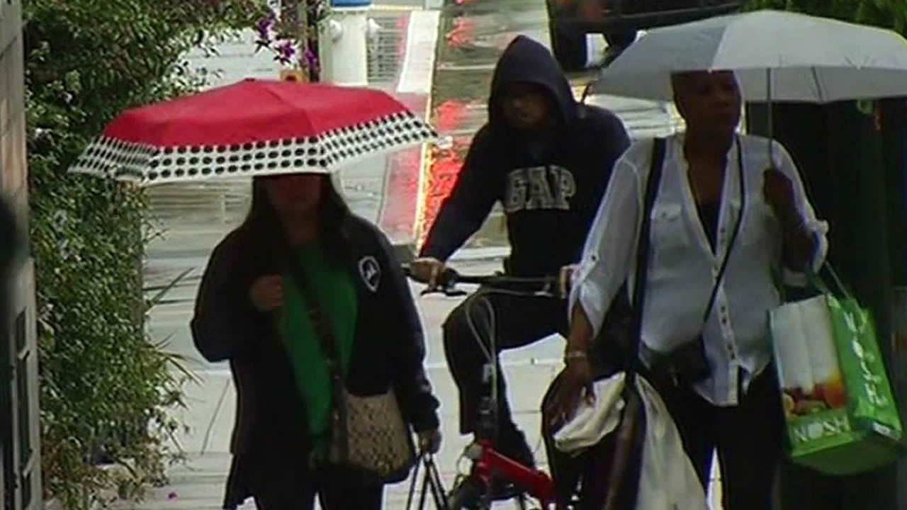 San Francisco residents walk with umbrellas as rain fell on June 10, 2015.