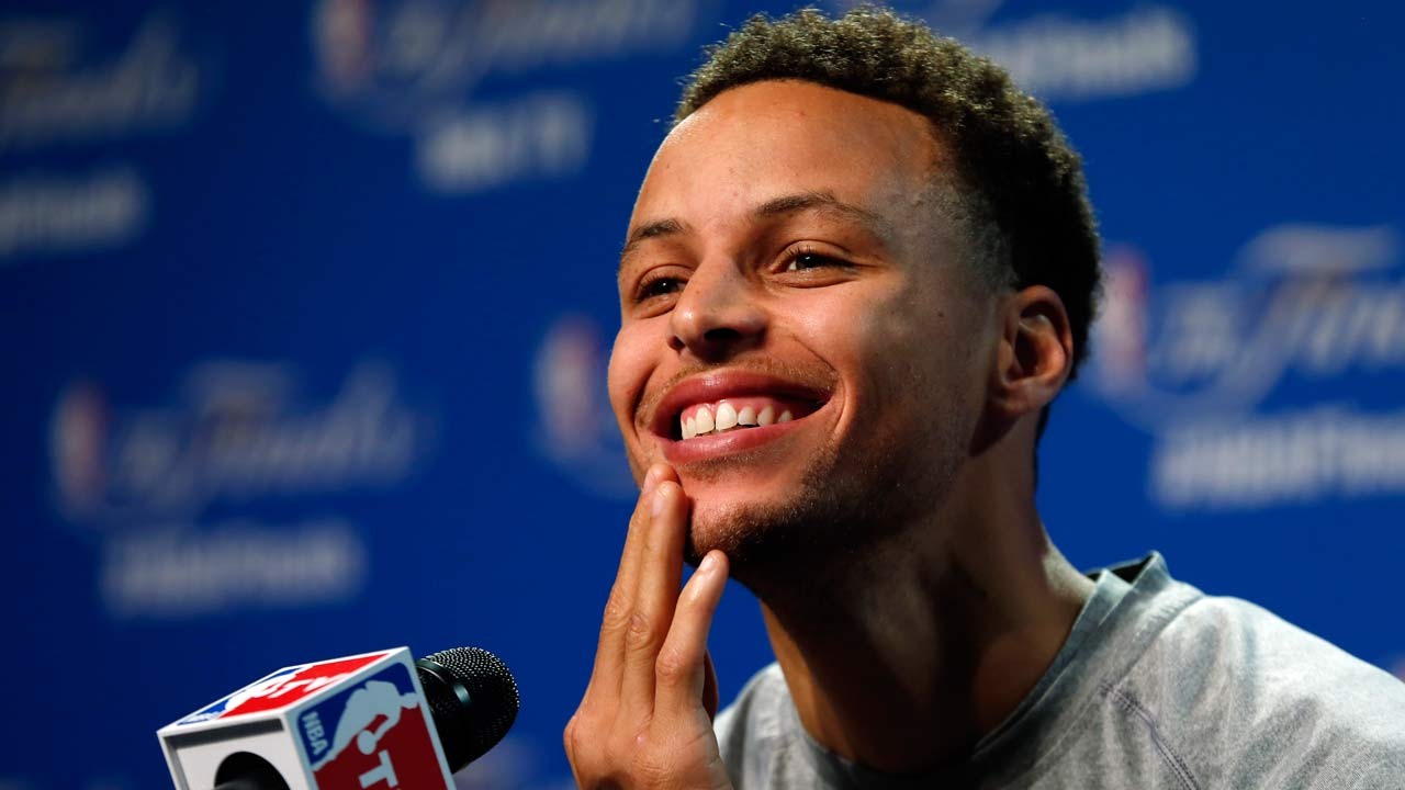 Golden State Warriors guard Stephen Curry answers a question during press conference for basketball's NBA Finals in Cleveland, Wednesday, June 10, 2015.