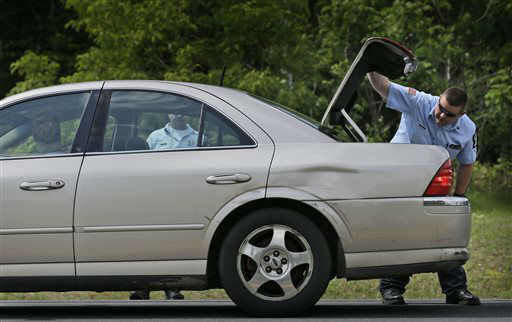 """<div class=""""meta image-caption""""><div class=""""origin-logo origin-image none""""><span>none</span></div><span class=""""caption-text"""">Law enforcement officials check the trunk of a car at a check point near the border of Dannemora, N.Y., Wednesday, June 10, 2015. (AP Photo/ Seth Wenig)</span></div>"""