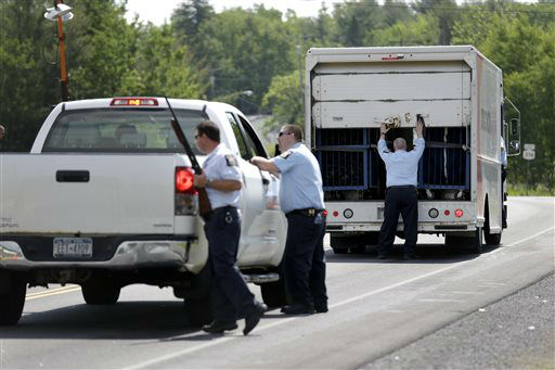"""<div class=""""meta image-caption""""><div class=""""origin-logo origin-image none""""><span>none</span></div><span class=""""caption-text"""">Law enforcement officials check the back of trucks at a check point near the border of Dannemora, N.Y., Wednesday, June 10, 2015. (AP Photo/ Seth Wenig)</span></div>"""