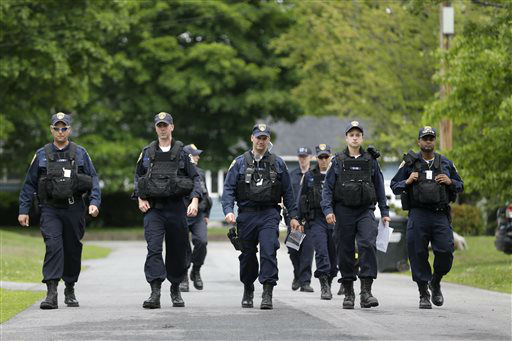 """<div class=""""meta image-caption""""><div class=""""origin-logo origin-image none""""><span>none</span></div><span class=""""caption-text"""">Law enforcement officers walk the streets in Dannemora, N.Y., as they searched houses near the maximum-security prison in northern New York. (AP Photo/ Seth Wenig)</span></div>"""