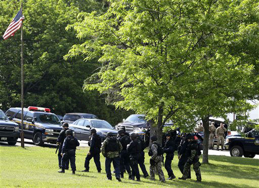 """<div class=""""meta image-caption""""><div class=""""origin-logo origin-image none""""><span>none</span></div><span class=""""caption-text"""">Heavily armed law enforcement officers stand near an area during a search for two escaped prisoners near Dannemora, N.Y. on Thursday, June 11. (AP Photo/ Seth Wenig)</span></div>"""