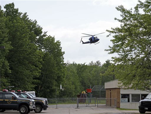 """<div class=""""meta image-caption""""><div class=""""origin-logo origin-image none""""><span>none</span></div><span class=""""caption-text"""">A helicopter lands briefly in the back yard of a community center in Dannemora, N.Y., Thursday, June 11, 2015. (AP Photo/ Seth Wenig)</span></div>"""