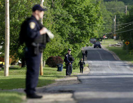 "<div class=""meta image-caption""><div class=""origin-logo origin-image none""><span>none</span></div><span class=""caption-text"">Law enforcement officers line a street near an area during a search for two escaped prisoners near Dannemora, N.Y., Thursday, June 11, 2015. (AP Photo/ Seth Wenig)</span></div>"