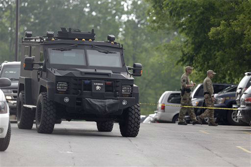"""<div class=""""meta image-caption""""><div class=""""origin-logo origin-image none""""><span>none</span></div><span class=""""caption-text"""">A heavily armored vehicle drives through a staging area during a search for two escaped prisoners near Dannemora, N.Y., Thursday, June 11, 2015. (AP Photo/ Seth Wenig)</span></div>"""