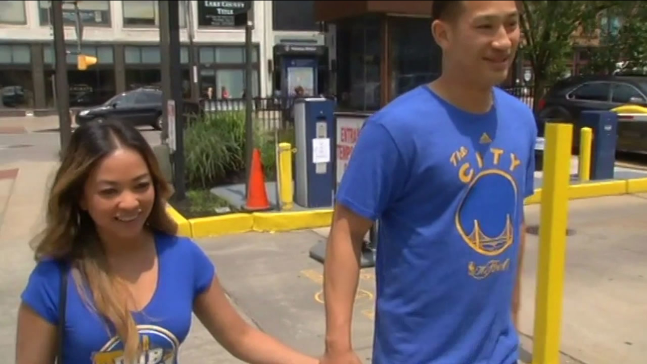 Golden State Warriors fans Richard Luk and April Santos walk in Cleveland ahead of Game 4 of the NBA Finals on June 11, 2015.