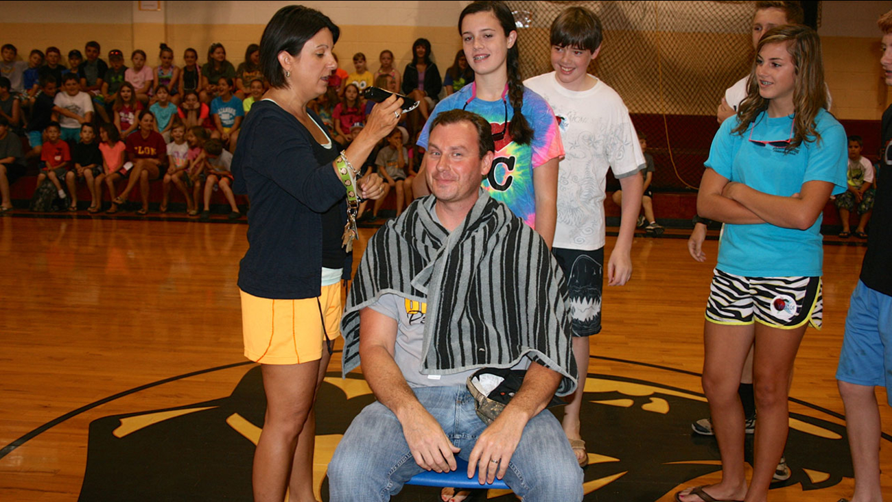 A principal in Chatham County lost his hair after making a deal with students.