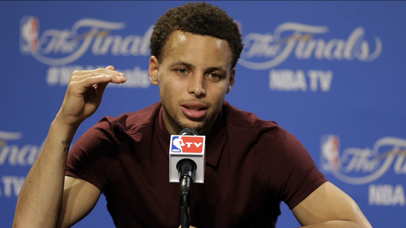 Warriors guard Stephen Curry (30) answers a question during a press conference following Game 4 of basketball's NBA Finals in Cleveland, early Friday, June 12, 2015.