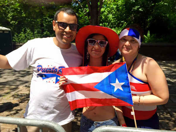 <div class='meta'><div class='origin-logo' data-origin='none'></div><span class='caption-text' data-credit=''>Hundreds of thousands of people packed New York's Fifth Avenue Sunday for the Puerto Rican Day parade.</span></div>