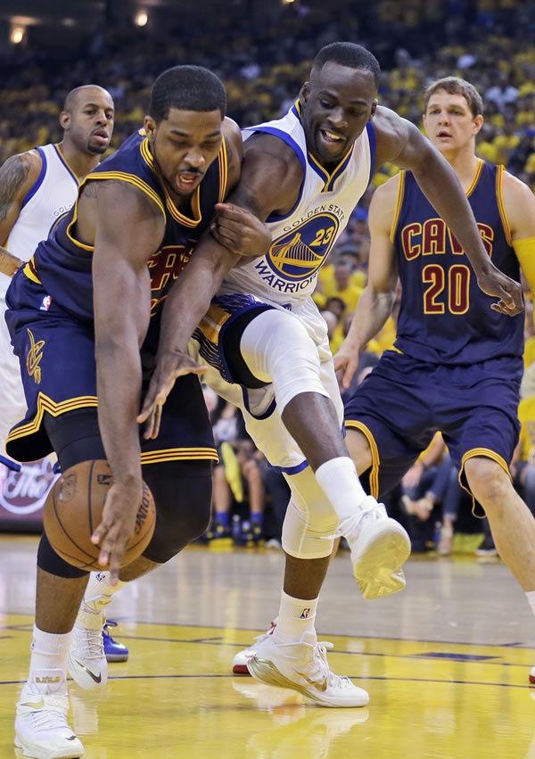 """<div class=""""meta image-caption""""><div class=""""origin-logo origin-image none""""><span>none</span></div><span class=""""caption-text"""">Cavaliers center Tristan Thompson and Warriors forward Draymond Green reach for the ball during the first half of Game 5 of the NBA Finals in Oakland, Calif., Sunday, June 14, 2015 (AP Photo/Ben Margot)</span></div>"""