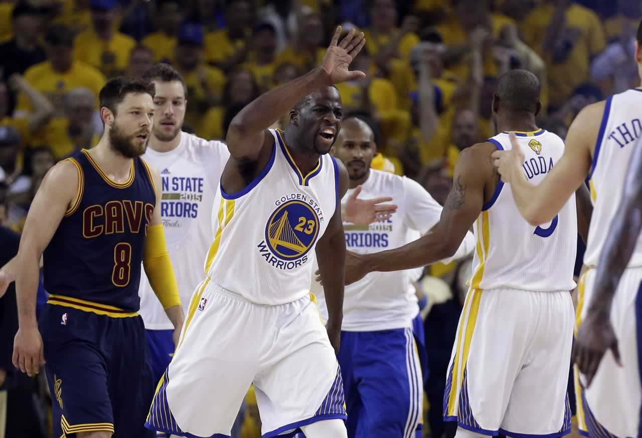 """<div class=""""meta image-caption""""><div class=""""origin-logo origin-image none""""><span>none</span></div><span class=""""caption-text"""">Warriors forward Draymond Green celebrates with teammates in front of Cavaliers guard Matthew Dellavedova during Game 5 of the NBA Finals in Oakland, Calif., Sunday, June 14, 2015. (AP Photo/Ben Margot)</span></div>"""