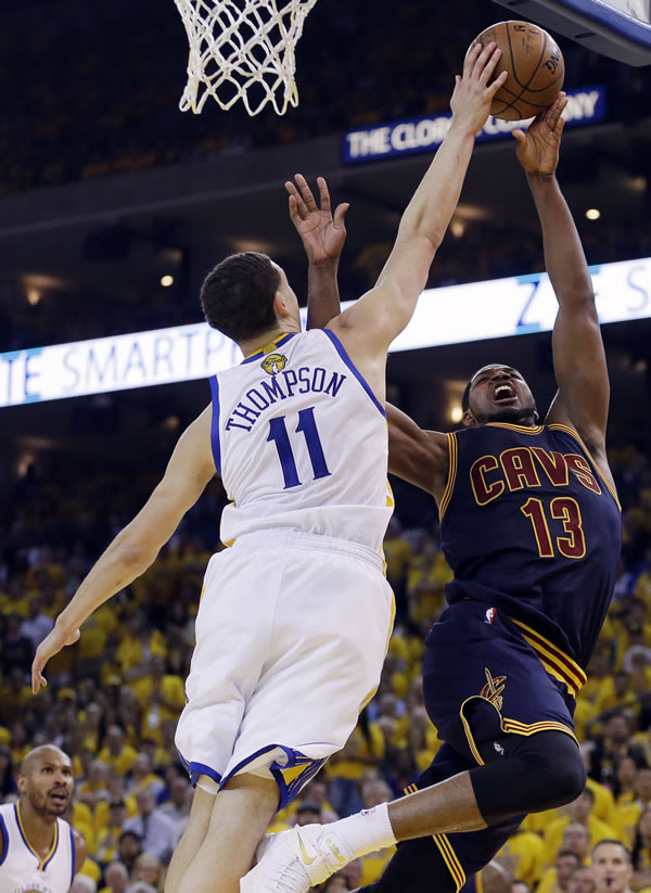 """<div class=""""meta image-caption""""><div class=""""origin-logo origin-image none""""><span>none</span></div><span class=""""caption-text"""">Warriors guard Klay Thompson defends a shot by Cavaliers center Tristan Thompson during Game 5 of the NBA Finals in Oakland, Calif., Sunday, June 14, 2015. (AP Photo/Ben Margot)</span></div>"""