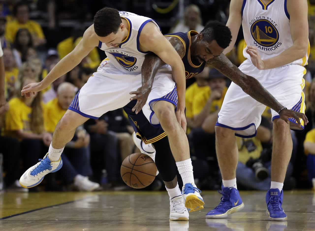 """<div class=""""meta image-caption""""><div class=""""origin-logo origin-image none""""><span>none</span></div><span class=""""caption-text"""">Cavaliers guard J.R. Smith, right, reaches for the ball behind Warriors guard Klay Thompson during Game 5 of the NBA Finals in Oakland, Calif., Sunday, June 14, 2015. (AP Photo/Ben Margot)</span></div>"""
