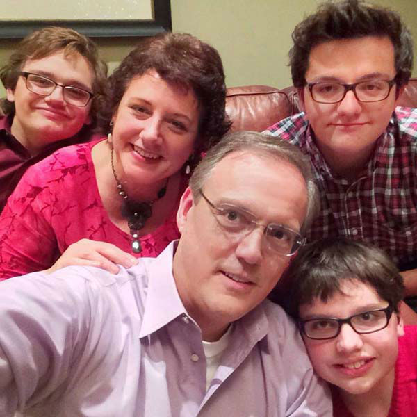 "<div class=""meta image-caption""><div class=""origin-logo origin-image none""><span>none</span></div><span class=""caption-text"">Tim Heller with his wife and three sons (KTRK Photo)</span></div>"