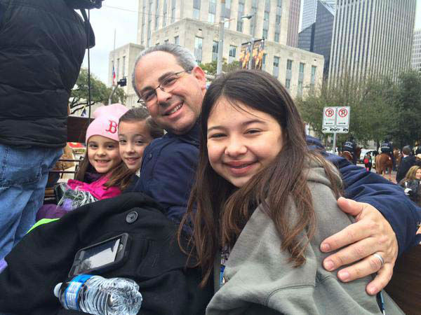"<div class=""meta image-caption""><div class=""origin-logo origin-image none""><span>none</span></div><span class=""caption-text"">Kevin Quinn and his daughters riding on the ABC-13 float in a parade (KTRK Photo)</span></div>"