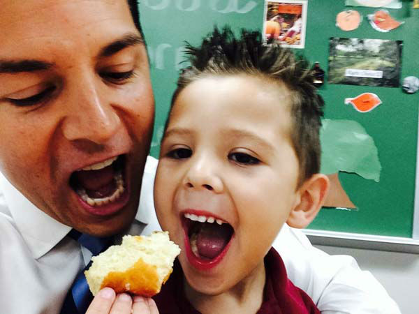 "<div class=""meta image-caption""><div class=""origin-logo origin-image none""><span>none</span></div><span class=""caption-text"">Erik Barajas eating donuts at his son's school (KTRK Photo)</span></div>"