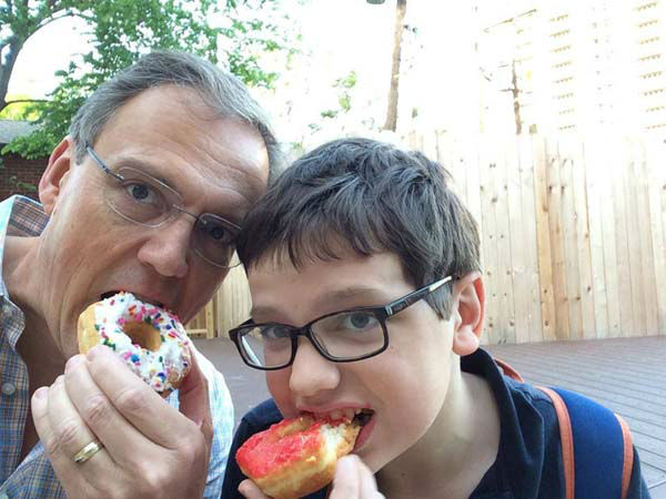 "<div class=""meta image-caption""><div class=""origin-logo origin-image none""><span>none</span></div><span class=""caption-text"">Tim Heller and his son enjoying donuts (KTRK Photo)</span></div>"