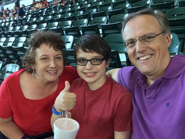 "<div class=""meta image-caption""><div class=""origin-logo origin-image none""><span>none</span></div><span class=""caption-text"">Tim Heller with his wife and their son at an Astros game (KTRK Photo)</span></div>"
