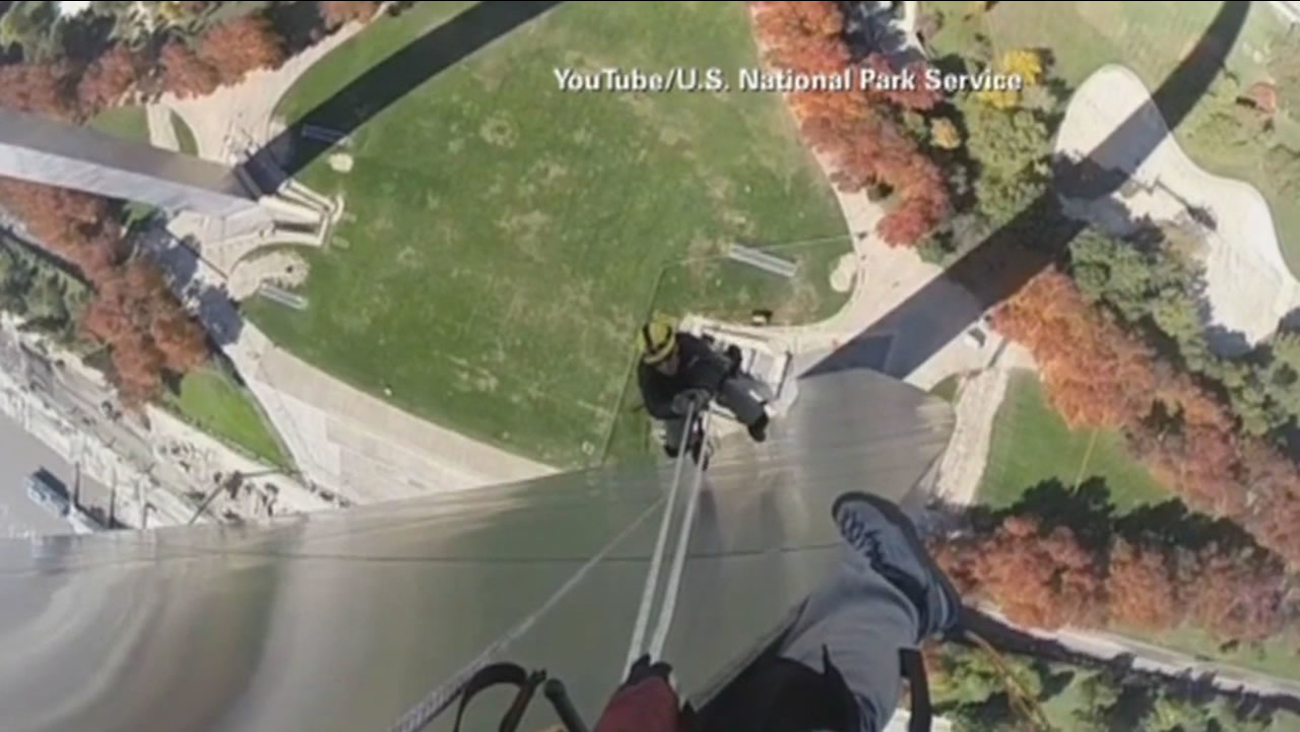 Videos provided by the National Park Service of the workers in action were shot with GoPro cameras mounted to the helmets of the arch walkers.