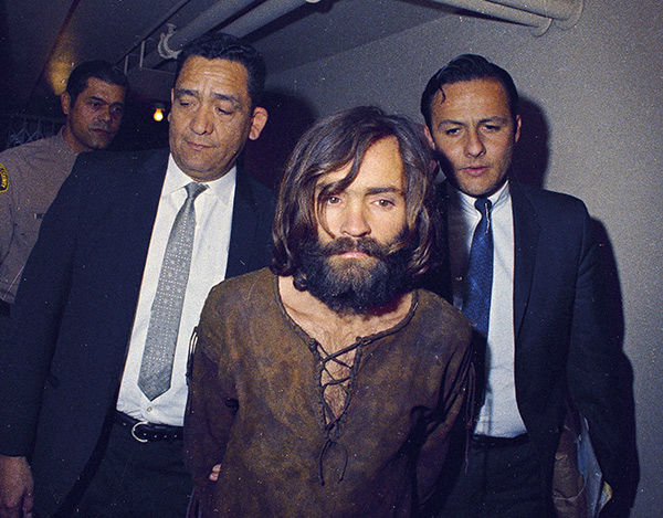 "<div class=""meta image-caption""><div class=""origin-logo origin-image none""><span>none</span></div><span class=""caption-text"">Charles Manson is escorted to his arraignment on conspiracy-murder charges in conneciton with the Sharon Tate murder case, 1969, Los Angeles, Calif. (AP Photo)</span></div>"