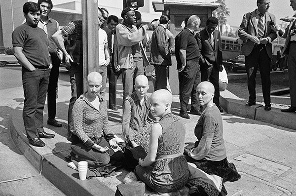 "<div class=""meta image-caption""><div class=""origin-logo origin-image none""><span>none</span></div><span class=""caption-text"">Four young female members of the Charles Manson 'family' kneel on the sidewalk outside the Los Angeles at Hall of Justice, March 29, 1971 with their heads shaved. (AP Photo/ Wally Fong)</span></div>"