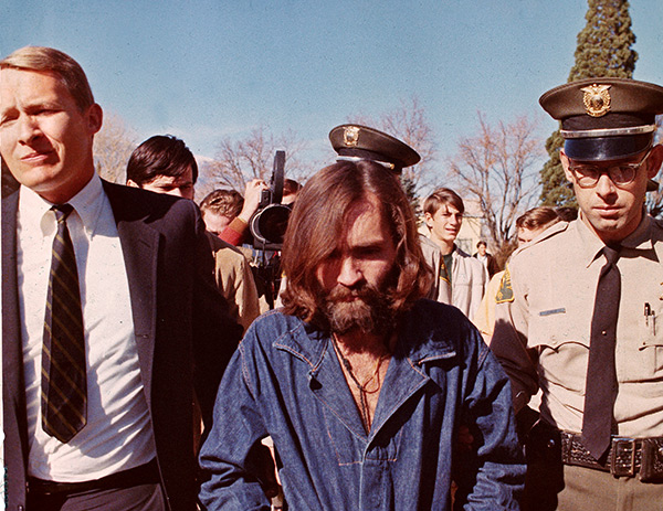 "<div class=""meta image-caption""><div class=""origin-logo origin-image none""><span>none</span></div><span class=""caption-text"">Charles Manson is escorted on his way back to jail after court arraignment in Los Angeles, Calif., Dec. 22, 1969. (AP Photo)</span></div>"