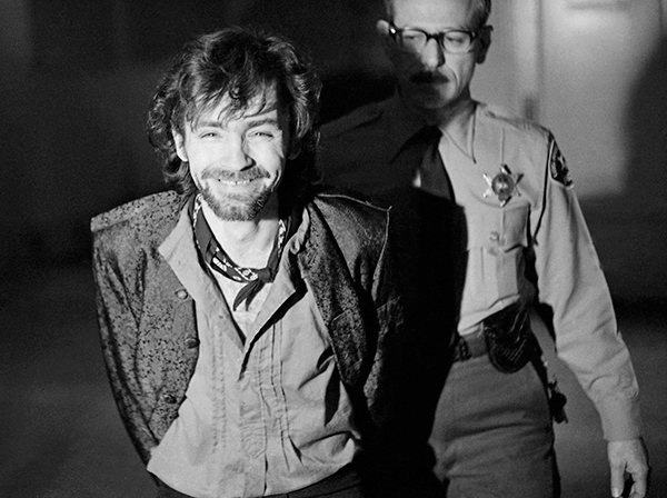 "<div class=""meta image-caption""><div class=""origin-logo origin-image none""><span>none</span></div><span class=""caption-text"">A scowling Charles Manson goes to lunch after an outbreak in court that resulted in his ejection, along with three women co-defendants, from the Tate murder trial, Dec. 21, 1970. (AP Photo/George Brich)</span></div>"