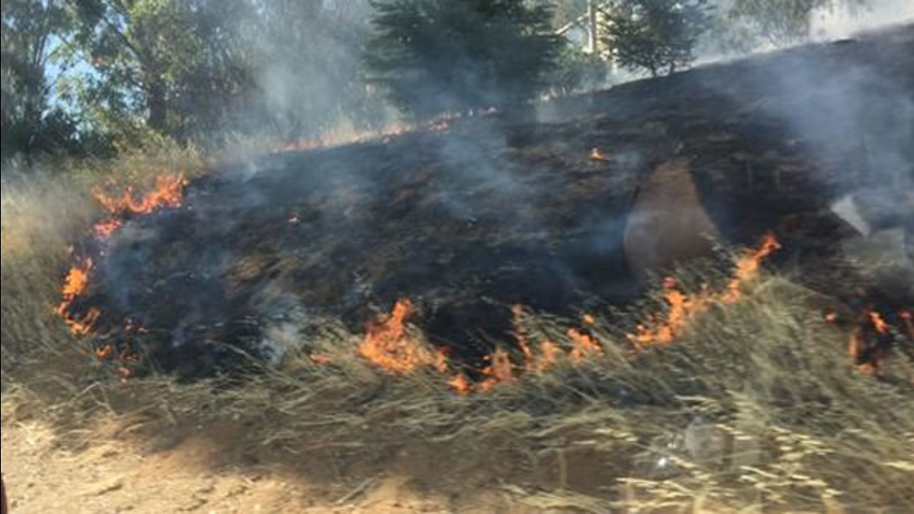 A two-alarm brush fire burned along I-280 near Magdalena Ave in Los Altos, Calif. on Monday, June 15, 2015.