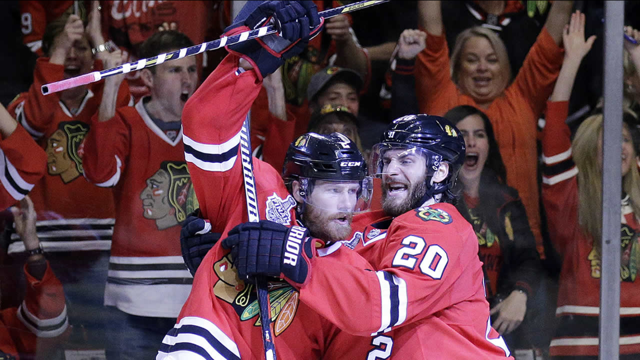 Chicago Blackhawks' Duncan Keith and Brandon Saad