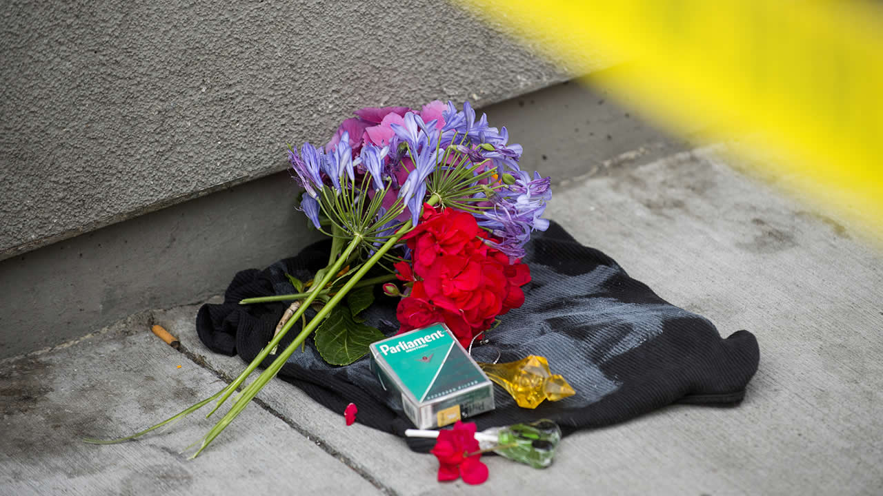 Flowers and a cigarette box form a makeshift shrine near the area where a fourth floor balcony collapsed in Berkeley, Calif.