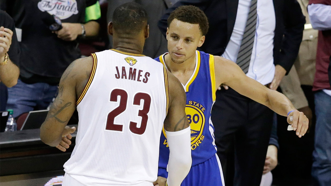 Cleveland Cavaliers forward LeBron James congratulates Golden State Warriors guard Stephen Curry during Game 6 of basketball's NBA Finals in Cleveland, Tuesday, June 16, 2015.