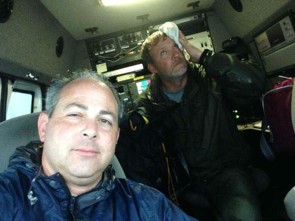 """<div class=""""meta image-caption""""><div class=""""origin-logo origin-image none""""><span>none</span></div><span class=""""caption-text"""">Kevin Quinn and his photographer Matt drying out in the live truck (KTRK Photo)</span></div>"""