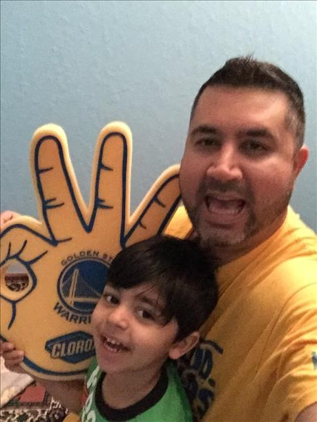 <div class='meta'><div class='origin-logo' data-origin='none'></div><span class='caption-text' data-credit='Photo submitted to KGO-TV by Irfan Rydhan/uReport'>Mustafa and his dad celebrating a Warriors win! Tag pics on Twitter, Facebook, Google Plus and Instagram using #DubsOn7.</span></div>