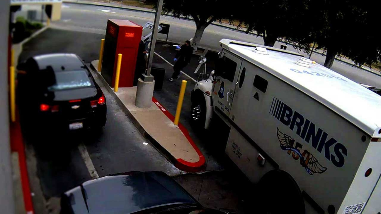 Surveillance video shows an armed suspect robbing an armored car employee outside of a Wells Fargo bank branch at 400 S. Market Street in Inglewood on Friday, April 24, 2015.