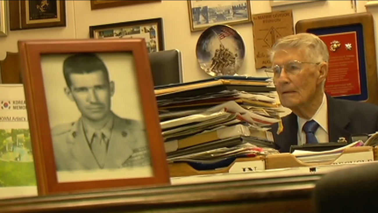 United States Marine Corps retired Lt. Col. John Stevens sits at his desk