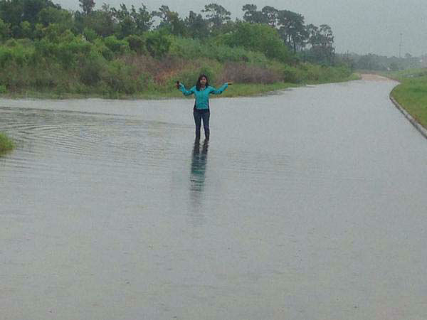 "<div class=""meta image-caption""><div class=""origin-logo origin-image none""><span>none</span></div><span class=""caption-text"">Pooja Lodhia standing in flood waters (KTRK Photo)</span></div>"