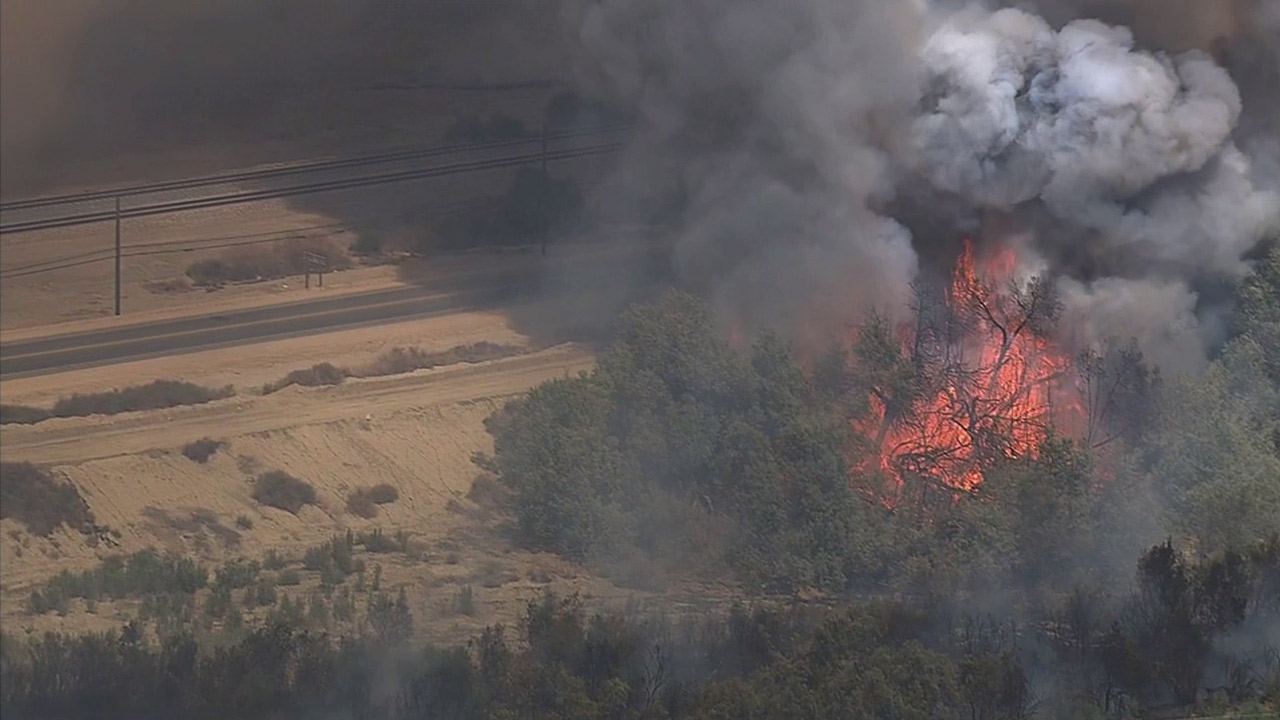 An aerial shot of the brush fire in Thermal is shown on Thursday, June 18, 2015.