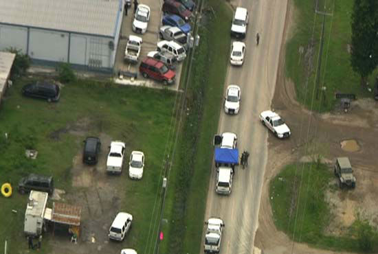 """<div class=""""meta image-caption""""><div class=""""origin-logo origin-image none""""><span>none</span></div><span class=""""caption-text"""">Deputies with guns drawn are seen at a warehouse in northeast Harris County during a lengthy standoff today. (KTRK Photo/ KTRK)</span></div>"""