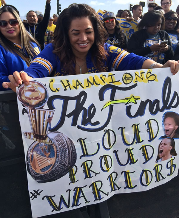 "<div class=""meta image-caption""><div class=""origin-logo origin-image none""><span>none</span></div><span class=""caption-text"">A Dubs fan shows off her sign during the Golden State Warriors parade in Oakland, Calif. on Friday, June 19, 2015. (KGO-TV)</span></div>"