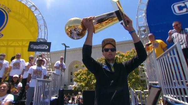 "<div class=""meta image-caption""><div class=""origin-logo origin-image none""><span>none</span></div><span class=""caption-text"">Golden State Warriors' star Steph Curry shows off the NBA championship trophy at the rally honoring the team outside Oakland's Kaiser Convention Center on Friday, June 19, 2015. (KGO-TV)</span></div>"
