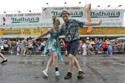 """<div class=""""meta image-caption""""><div class=""""origin-logo origin-image none""""><span>none</span></div><span class=""""caption-text"""">Participants dance on Surf Avenue during the 33rd annual Mermaid Parade in New York's Coney Island on Saturday, June 20, 2015.  (AP Photo/Mary Altaffer) (AP Photo/ Mary Altaffer)</span></div>"""