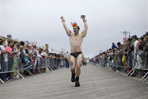 """<div class=""""meta image-caption""""><div class=""""origin-logo origin-image none""""><span>none</span></div><span class=""""caption-text"""">A participant marches on the boardwalk during the 33rd annual Mermaid Parade in New York's Coney Island on Saturday, June 20, 2015. (AP Photo/Mary Altaffer) (AP Photo/ Mary Altaffer)</span></div>"""
