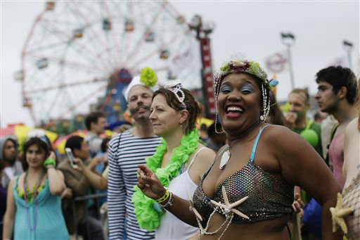 """<div class=""""meta image-caption""""><div class=""""origin-logo origin-image none""""><span>none</span></div><span class=""""caption-text"""">Participants march on the boardwalk during the 33rd annual Mermaid Parade in New York's Coney Island on Saturday, June 20, 2015.  (AP Photo/Mary Altaffer) (AP Photo/ Mary Altaffer)</span></div>"""