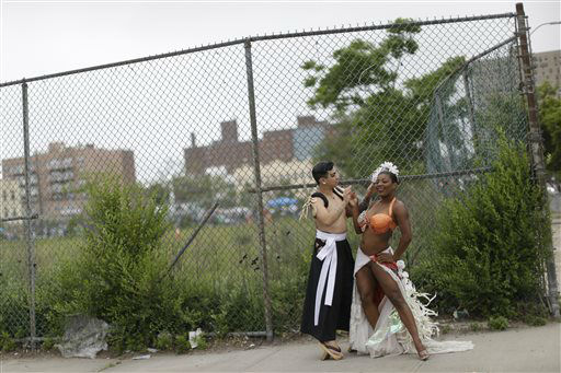 """<div class=""""meta image-caption""""><div class=""""origin-logo origin-image none""""><span>none</span></div><span class=""""caption-text"""">Ms Perle Noire, right, has her make up done by Alston Stephanus before the start of the 33rd annual Mermaid Parade at New York's Coney Island on Saturday.  (AP Photo/Mary Altaffer) (AP Photo/ Mary Altaffer)</span></div>"""