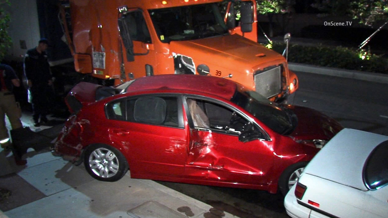 A big rig driver slammed into 10 empty parked cars in a Brea neighborhood early Saturday, June 20, 2015.