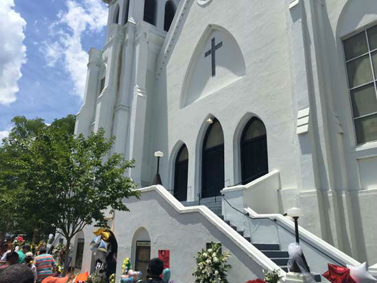 "<div class=""meta image-caption""><div class=""origin-logo origin-image none""><span>none</span></div><span class=""caption-text"">Church leaders were allowed in to Mother Emanuel Church Saturday, including the fellowship hall where the massacre took place, and prayed over it as they walked. (Tracy Clemmons/KTRK)</span></div>"