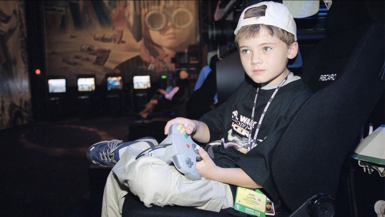 "Jake Lloyd, who portrays young Anakin Skywalker in the film ""Star Wars Episode 1,"" plays a game during the Electronic Entertainment Expo in Los Angeles on May 13, 1999."