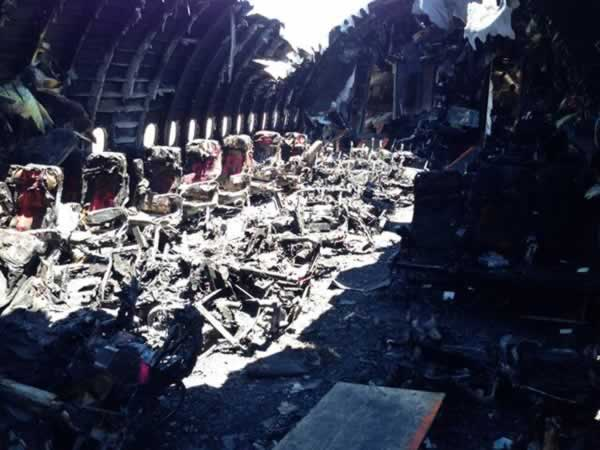 <div class='meta'><div class='origin-logo' data-origin='none'></div><span class='caption-text' data-credit='NTSB/Twitter'>Photo of charred cabin interior of Asiana flight 214.</span></div>