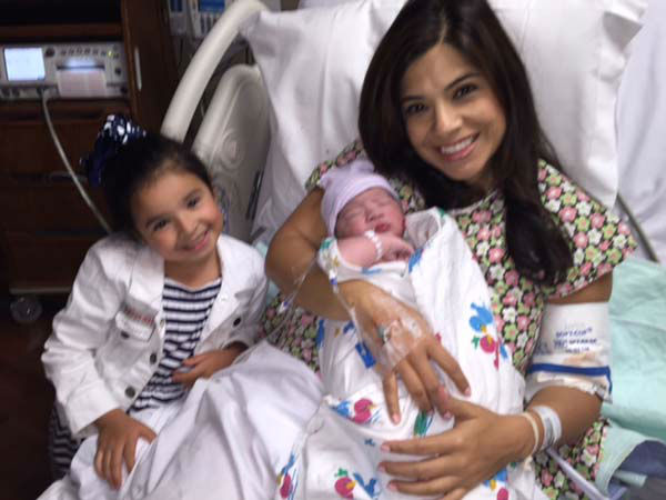 """<div class=""""meta image-caption""""><div class=""""origin-logo origin-image none""""><span>none</span></div><span class=""""caption-text"""">Patricia with her second oldest daughter Liliana and the new addition (KTRK Photo)</span></div>"""